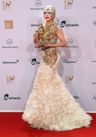 The singer accepts her Bambi Award in an ornate Alexander McQueen gown and headdress on November 10, 2011.