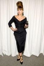 She wears an off-the-shoulder dress at the launch for her fragrance, Fame Eau de Parfum on September 14, 2012.