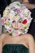 Gaga wears a Philip Treacy headdress at the designer's fall 2013 show on September 16, 2012.