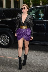 Gaga pairs her Balmain outfit with Azzedine Alaïa booties while promoting Applause in New York City on August 19, 2013.