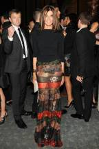 Carine Roitfeld, dancing the night away in this sheer bell bottom festive little look. Balancing out the crazy colors with a black top, is one hell of a chic move.