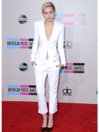 Miley can make any 'boy-trend' fashionable. It's true, it's the Chanel part of her fashion aesthetic in 2013.